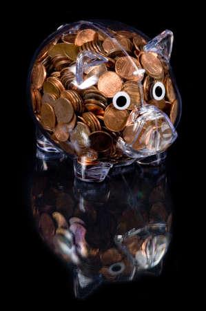 アメリカの銅貨の完全透明なプラスチックの貯金銀行 写真素材 - 2668331