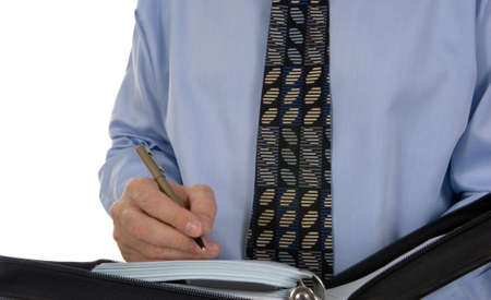 scheduling system: Business man writing, scheduling in paper organizer, calendar