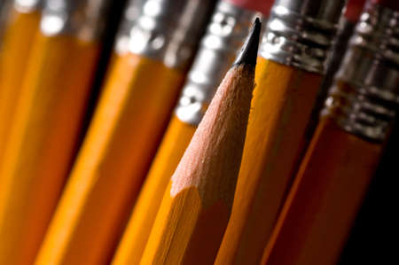Macro of yellow pencils, focus is on the sharp pencil lead the rest of the pencils are out of focus, copy space to the left 版權商用圖片