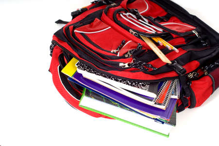 bookbag: A red school backpack full of school supplies