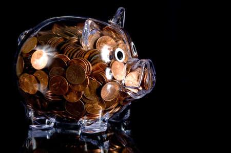 アメリカの銅貨の完全透明なプラスチックの貯金銀行 写真素材 - 2697969