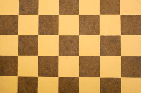 A brown and yellow antique checkerboard background