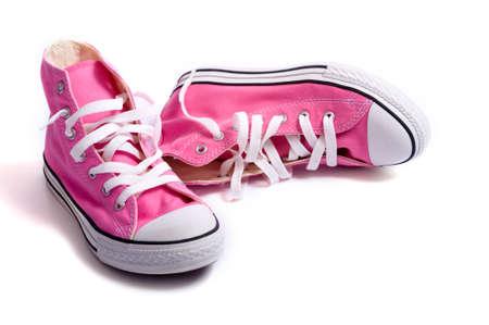 スニーカー: バスケット ボール シューズのピンク ビンテージ スタイルを作られたキャンバスまたはコピー領域の白い背景の上のスニーカーのペア 写真素材
