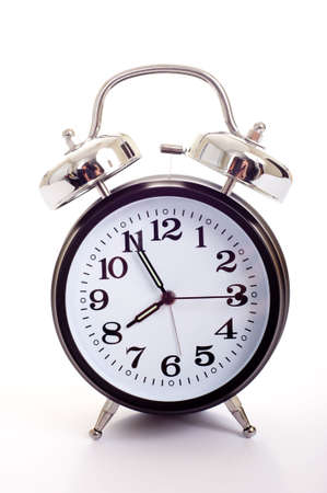 A black, vintage looking alarm clock on white background Stock Photo - 3038325