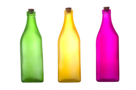 closed corks: Colorful bottles on a white background with copy space Stock Photo
