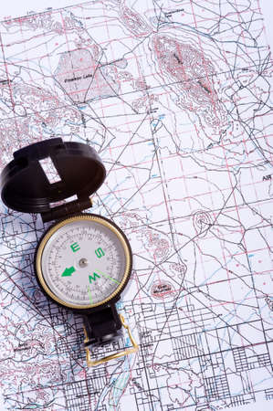 topographical: A compass lying on top of a topographical map