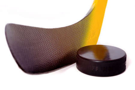 A colorful hockey stick and puck on a white background.  The words on the puck say official and Chezk.  They are not trademarks they designate the pucks status and its country of origin.