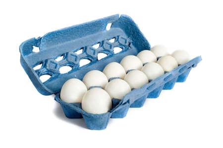 dozen: Farm Fresh Egg on a white background in a blue carton Stock Photo