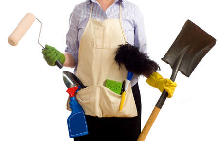 redecorating: A woman with various spring cleaning and redecorating items including a paint brushes, garden tools, cleaning chemicals and items.  Spring time chores Stock Photo