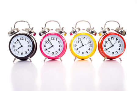 a group of multicolor clocks on a white background with copy space Banco de Imagens