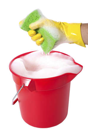 sudsy: A sudsy bucket or pale of soap with a hand holding a sponge. cleaning concept or chores
