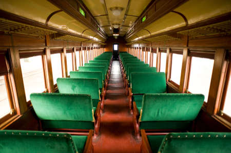 wide angle: Wide angle view of the inside of a vintage, antique passenger train cabin Stock Photo