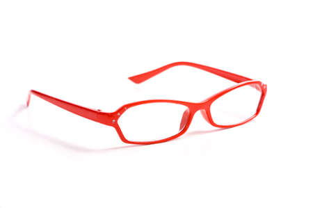 A pair of red reading glasses on white background with copy space