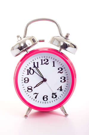 a bright pink vintage looking alarm clock on a white background Stock Photo - 3874842