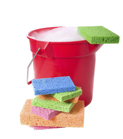 sudsy: A red plastic bucket on a white background with several brightly colored sponges.  Cleaning theme