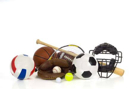 Sports gear or equipment on white background including baseball items, a bat, glove and ball and a catchers mask, an american football, a soccer ball, a volleyball, a tennis racket and ball, a golf bll photo