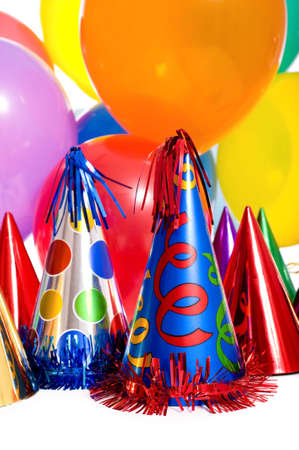 Birthday party background with party hats, floating balloons and streamers