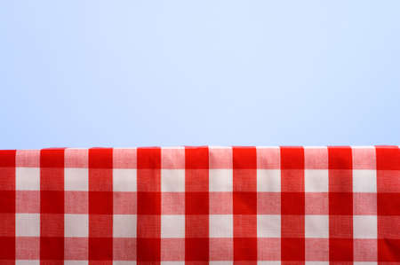A summertime or springtime picnic background with a gingham tablecoth and a blue sky with ample copy space Stock Photo - 4722903