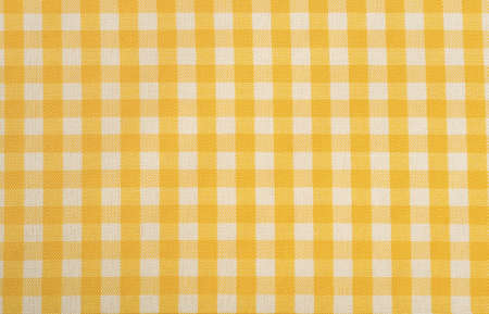 Yellow Gingham or checked tablecloth background 版權商用圖片