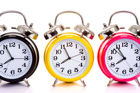 daylight savings time: a group of multicolor clocks on a white background with copy space Stock Photo