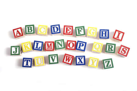 learing: A childs alphabet blocks on a white background