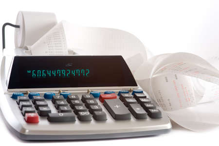 machine: An adding machine or calculator with adding machine tape or paper.