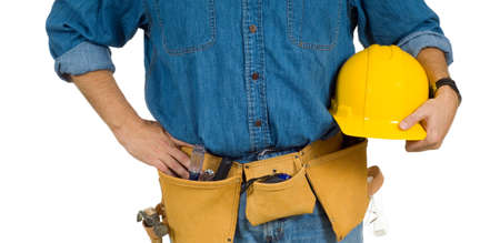 A construction worker on white background holding a hard hat and wearing a leather tool belt photo