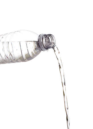 A bottle of water being poured out on a white background with copy space Reklamní fotografie