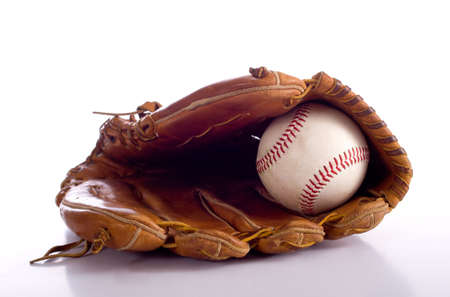 A brown leather baseball glove and a baseball on a white background with copy space photo