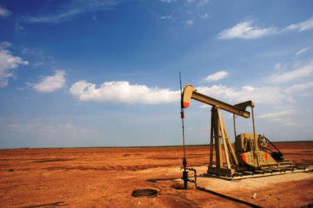 An oil pump or pumpjack on the plains of west Texas, United States of America photo