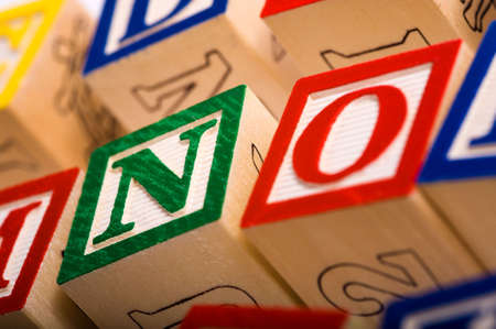 learing: A childs alphabet blocks on a white background with the word NO focus is on the N