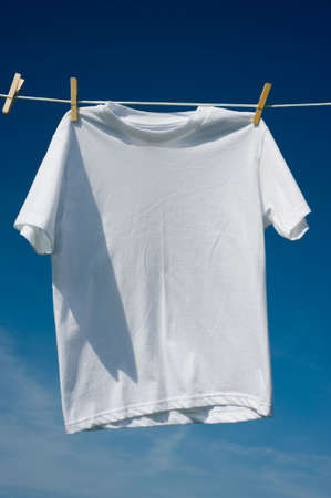 add text: Individual t-shirts on a clothesline in front of a beautiful blue sky.  Add text or graphics to shirts, copy space