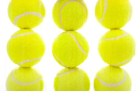 Several tennis balls on a white background with copy space photo