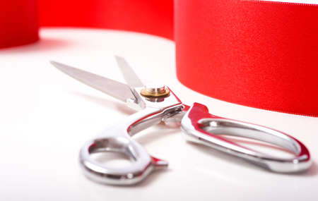 ceremonial: A red ribbon with a pair or shiny silver ceremonial scissors or sheers