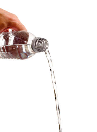 spilling: A bottle of water being poured out on a white background with copy space Stock Photo