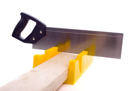A small yellow miter box or saw on a white background Stock Photo