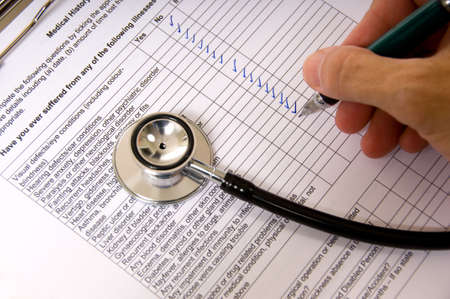 questionaire: A doctor or nurse completing a patient questionaire with a stethoscope Stock Photo