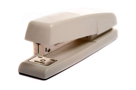 office stapler: A brown office stapler on a white background with copy space