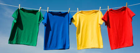 a set of primary colored T-shirts hanging on a clothesline on a beautiful, sunny day, add text or graphic to shirts or copy space Stock Photo - 4725670