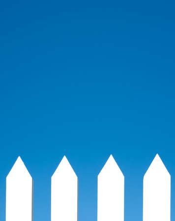 A white picket fence background in front of a bright blue sky with copy space. Stock Photo - 4725342