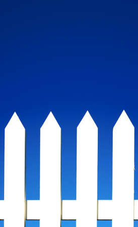 A white picket fence background in front of a bright blue sky with copy space. Stock Photo - 4725354