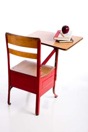 school desk: A red, vintage school desk on a white background with books and an apple with copy space Stock Photo