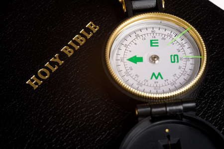 An engineers directional compass on a Bible, concept of guidance or direction photo