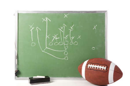 A diagram of a football play on a chalkboard with a football, chalk, eraser ane a whistle Stok Fotoğraf