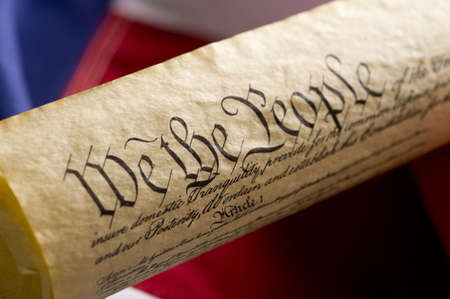 constitution: A copy of the United States Constitution on an Amercan Flag Background Stock Photo
