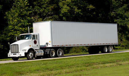 road tractor: A 18-wheel truck on a highway, transportation industry