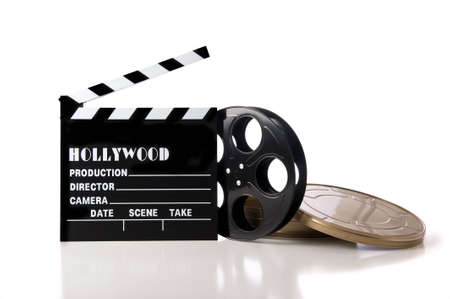 one item: Hollywood movie items including a clapboard and a movie reel and tin on a white background