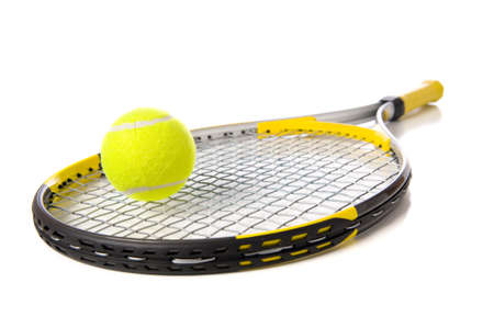 A tennis ball and racket on a white background photo