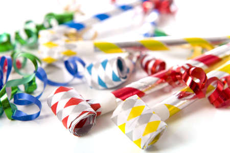 noise maker: A group of party items, noisemakers and ribbons, on a white background, New Years theme