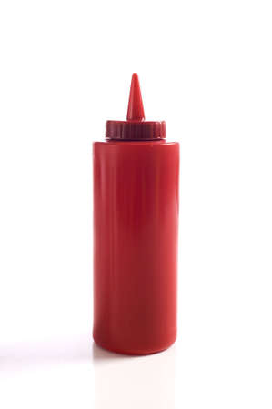 A red ketchup bottle on a white background with copy space Banco de Imagens
